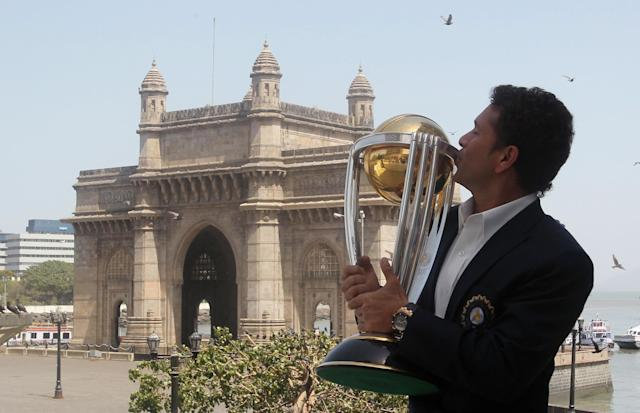 Indian cricketer Sachin Tendulkar kisses the ICC Cricket World Cup trophy with the Gateway of India monument in the background during a photo call at the Taj Mahal hotel in Mumbai on April 3, 2011. India won the Cricket World Cup for the first time since 1983 with a six-wicket victory over Sri Lanka on April 2. AFP PHOTO/STR (Photo credit should read STRDEL/AFP/Getty Images)
