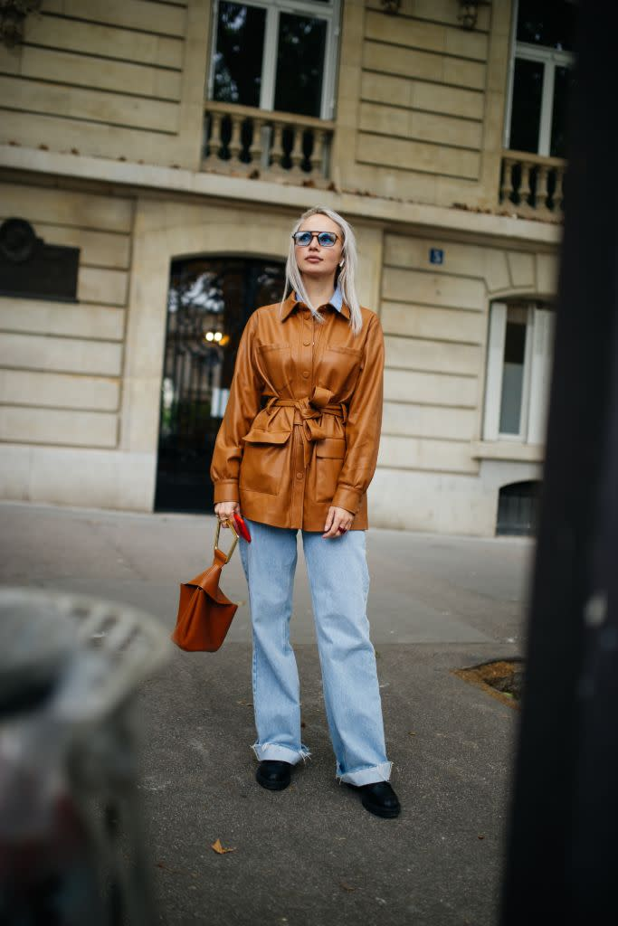 A brown leather trench and coordinating bag at Paris Couture. - Credit: WWD