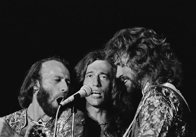 In this Nov, 6, 1979, file photo, the Bee Gees from left, Maurice, Robin and Barry Gibb sing close into the microphone at a Miami Beach concert in Miami. November 6, 1979. A representative said on Sunday, May 20, 2012, that Robin Gibb has died. He was 62. (AP Photo/Phil Sandlin, File)