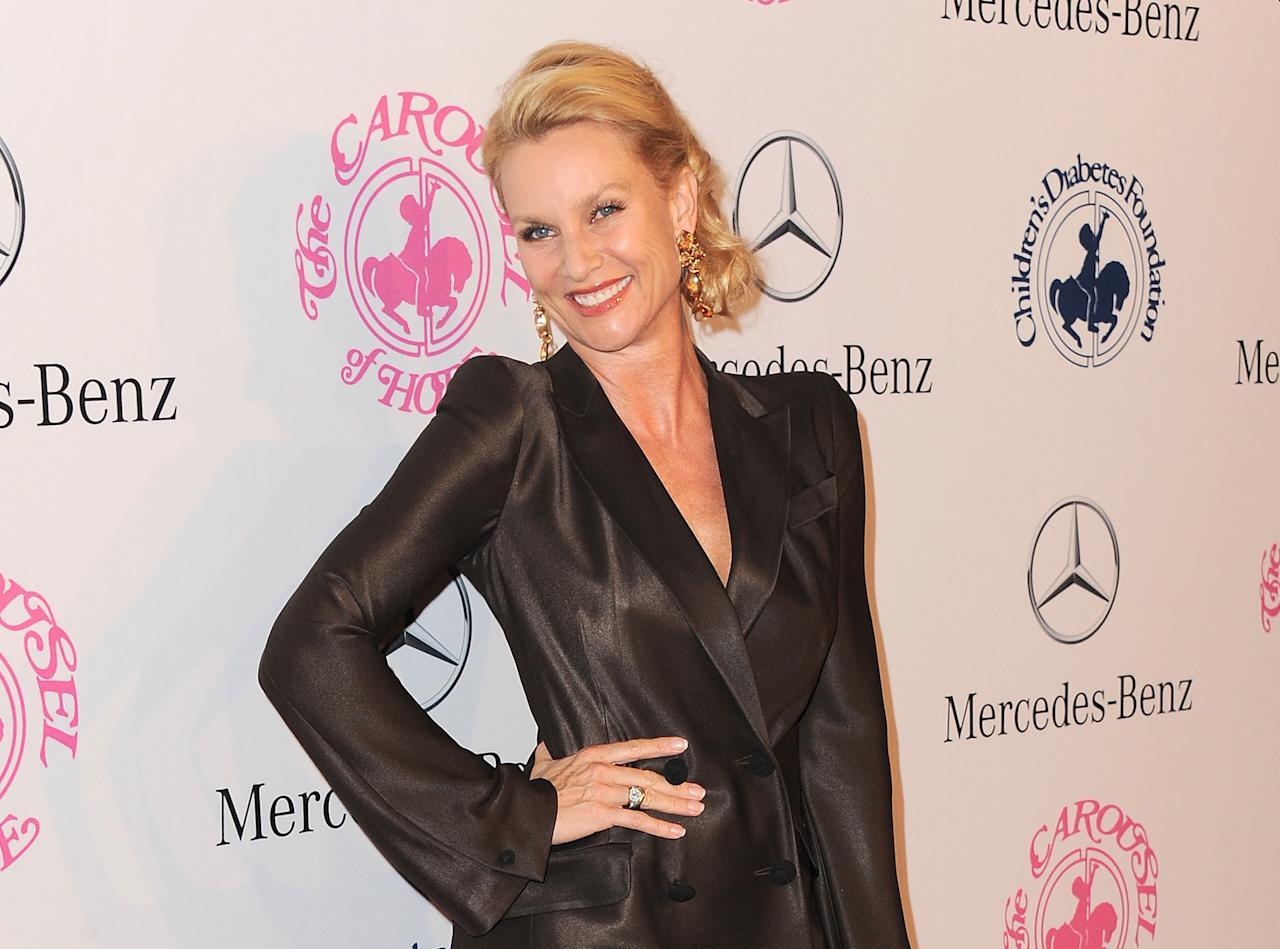 "FILE - In this Oct. 20, 2012 file photo, Nicollette Sheridan arrives at The Carousel of Hope at The Beverly Hilton Hotel, in Beverly Hills. A Los Angeles judge on Wednesday, Jan. 29, 2014, reversed an earlier ruling dismissing Sheridan's lawsuit over her departure from the hit ABC series, ""Desperate Housewives."" (Photo by Jordan Strauss/Invision/AP, File)"