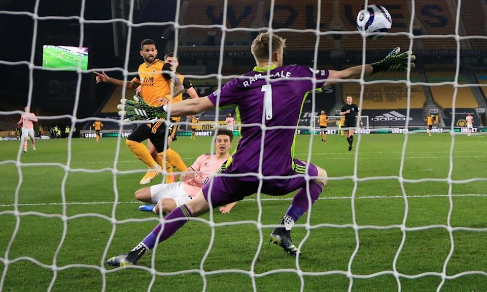 Wolverhampton Wanderers' Willian Jose sweeps the ball past Sheffield United goalkeeper Aaron Ramsdale to open the scoring.