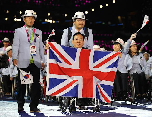 LONDON, ENGLAND - AUGUST 29: Athlete Ctyu Dae Kim of Republic of Korea carries the flag during the Opening Ceremony of the London 2012 Paralympics at the Olympic Stadium on August 29, 2012 in London, England. (Photo by Dan Kitwood/Getty Images)