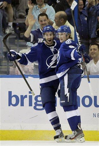 Tampa Bay Lightning center Steven Stamkos (91) celebrates with teammate Teddy Purcell (16) after scoring a goal against the Montreal Canadiens during the first period of an NHL hockey game Tuesday Feb. 28, 2012, in Tampa, Fla. (AP Photo/Chris O'Meara)