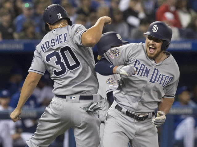 San Diego Padres' Hunter Renfroe celebrates with Eric Hosmer after Renfroe hit a three-run home run against the Toronto Blue Jays during the eighth inning of a baseball game Friday, May 24, 2019, in Toronto. (Fred Thornhill/The Canadian Press via AP)