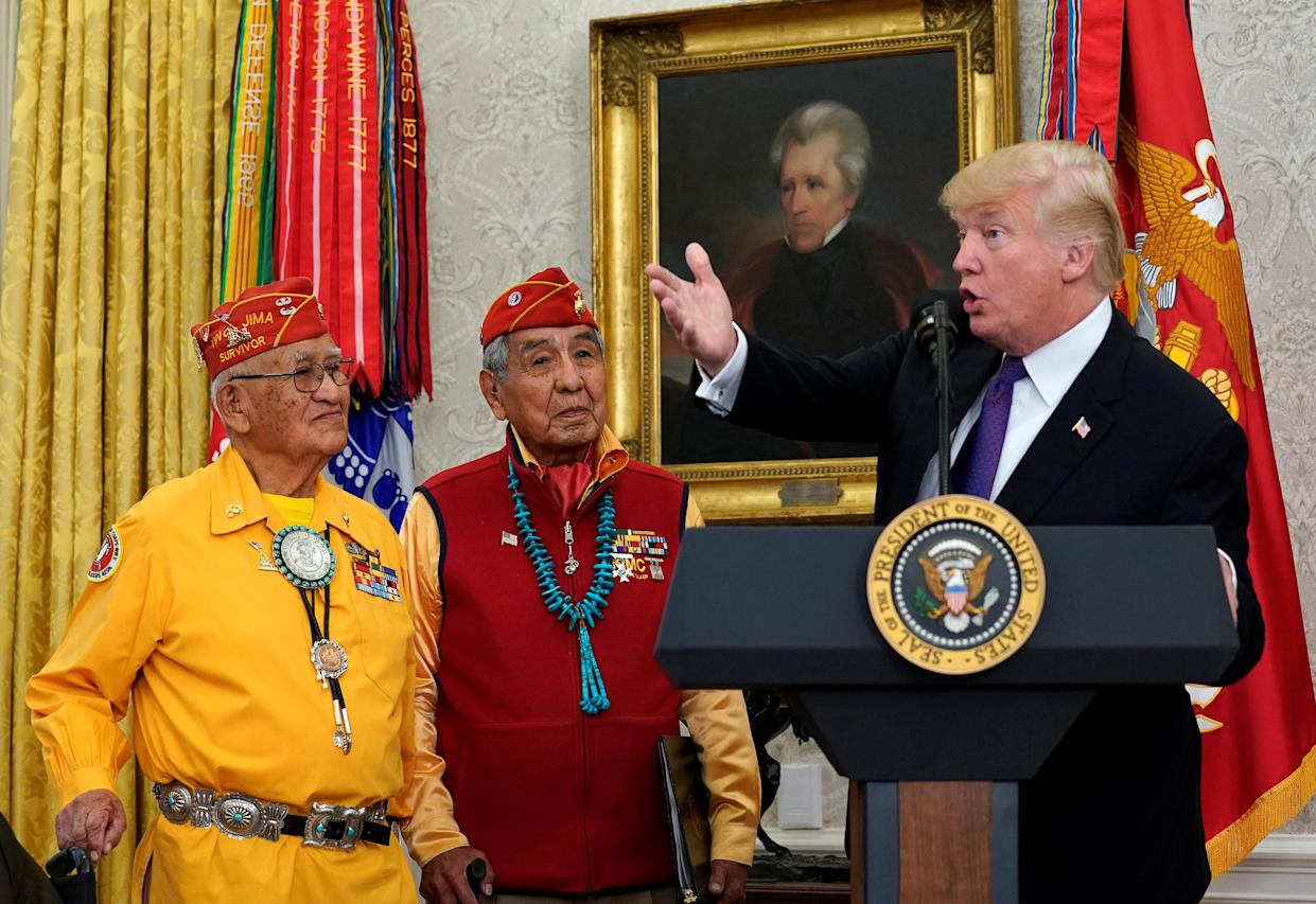 President Trump gestures as he hosts an event honoring the Native American code talkers at the White House on Monday. (Kevin Lamarque/Reuters)