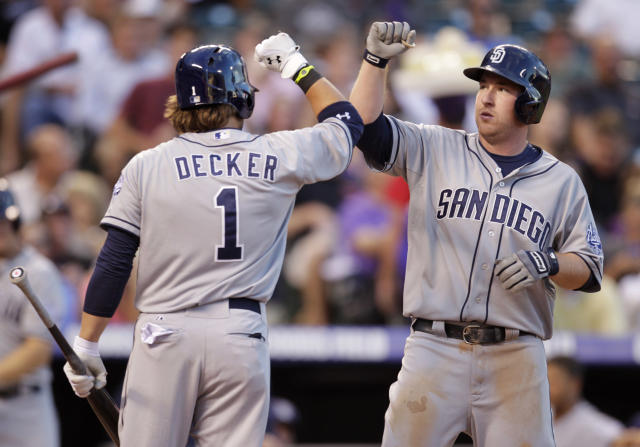 San Diego Padres' Jeff Decker (1) congratulates Padres' Jedd Gyorko after Gyorko's solo home run in the third inning of a baseball game against the Colorado Rockies in Denver on Tuesday, Aug. 13, 2013.(AP Photo/Joe Mahoney)