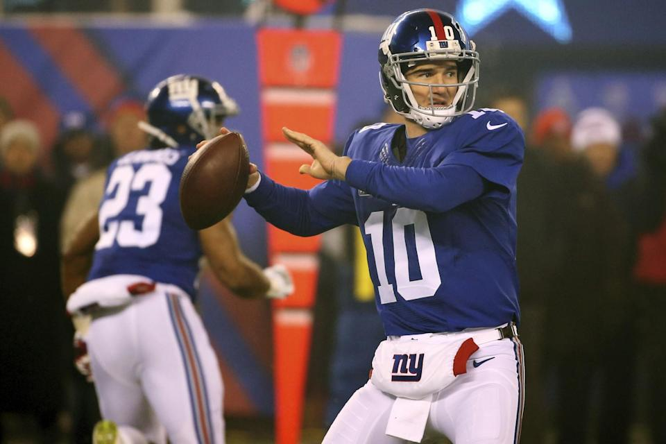 Eli Manning, right, said the New York Giants had communication problems against the Dallas Cowboys. Did they solve them illegally? (AP)
