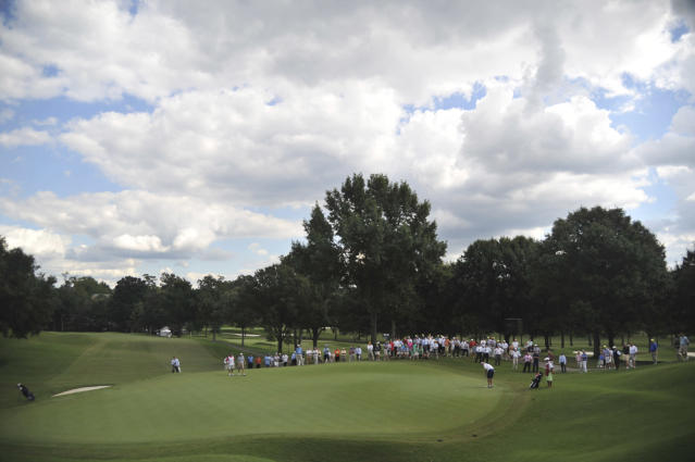 Spectators gather around the sixth green to watch Michael McCoy putt, during the U.S. Mid-Amateur Championship golf tournament at Country Club of Birmingham on Thursday, Oct. 10, 2013. McCoy defeated Bill Williamson 8 and 6. (AP Photo/AL.com, Frank Couch)