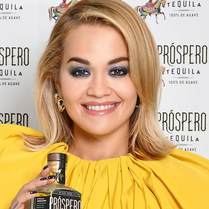 """The contrasting blonde shades in Rita Ora's color are flattering for a wide variety of skin tones. """"By maintaining some darkness closer to the root, the color feels more grounded and natural,"""" explains DeBolt. """"There is also a play between lighter and darker colors to create a pretty, honey-toned contrast between different shades of blonde."""" To get a similar hue, ask your colorist for highlights with a subtle root shadow. """"Request a buttery, warm shade of blonde — nothing too smoky or ashy,"""" adds DeBolt."""