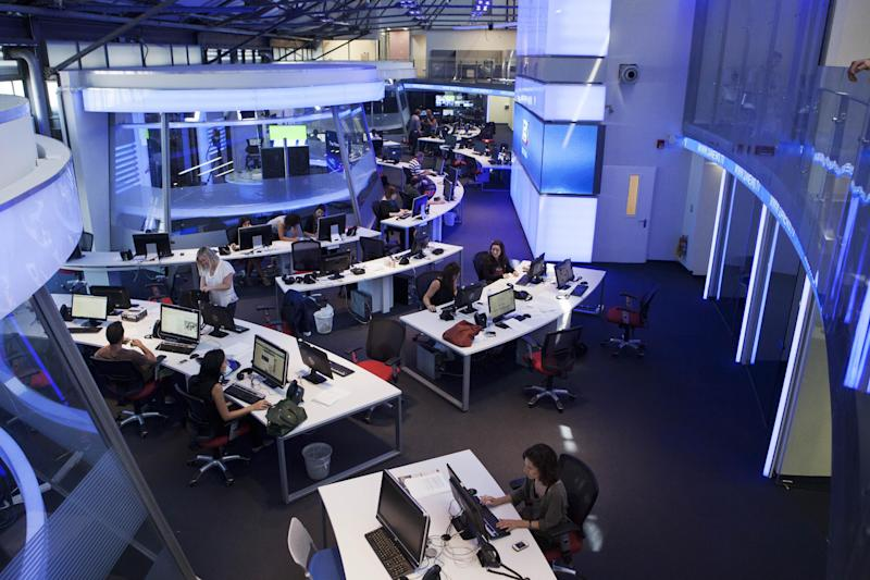 In this Sunday, July 28, 2013 photo, journalists works inside a studio of the new television channel I24news in Tel Aviv, Israel. The station's founders insist they are not an Israeli version of Al-Jazeera, the powerful broadcaster from the Gulf. They say they receive no government funding, hold no political affiliation and pledge to cover the news dispassionately and objectively. (AP Photo/Dan Balilty)