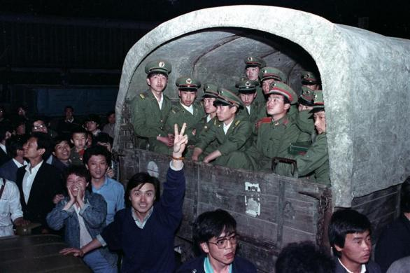 Residents of Beijing surround an army convoy of 4,000 soldiers in a suburb of the city to prevent them from continuing to Tiananmen Square, May 20, 1989.