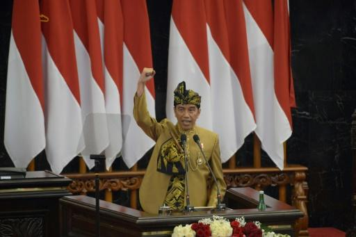 President Joko Widodo, wearing a traditional outfit for his address, wants to relocate the Indonesian capital to the island of Borneo but did not give a timetable for the move