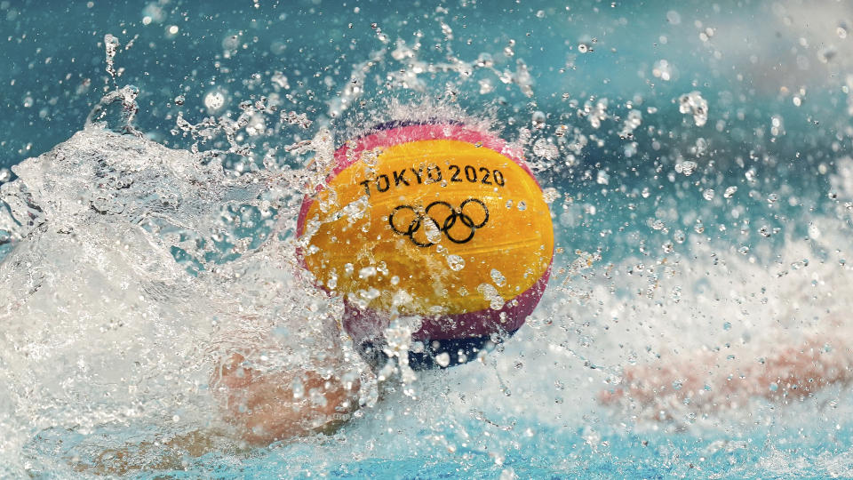 <p>Players reach for the ball at the start of the fourth quarter during a preliminary round men's water polo match between Italy and South Africa at the 2020 Summer Olympics, Sunday, July 25, 2021, in Tokyo, Japan. (AP Photo/Mark Humphrey)</p>