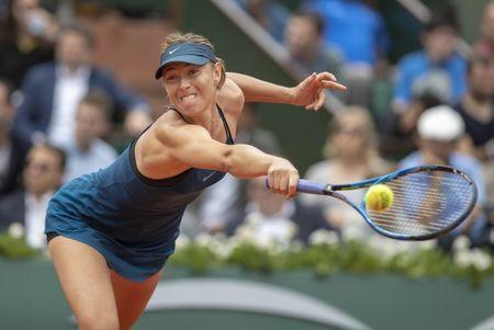 Jun 6, 2018, Paris, France: Maria Sharapova (RUS) in action during her match against Garbine Muguruza (ESP) on day 11 of the 2018 French Open at Roland Garros. Susan Mullane-USA TODAY Sports
