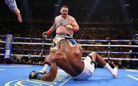 Andy Ruiz knocks down Anthony Joshua in the third round - Credit: GETTY IMAGES