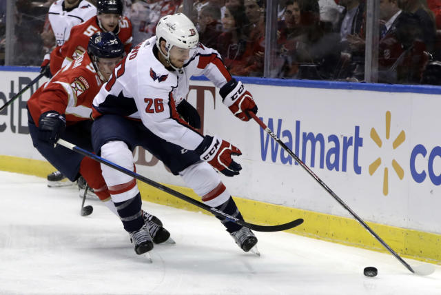 Washington Capitals center Nic Dowd (26) skates with the puck as Florida Panthers center Henrik Borgstrom (95) defends during the first period of an NHL hockey game, Monday, April 1, 2019, in Sunrise, Fla. (AP Photo/Lynne Sladky)