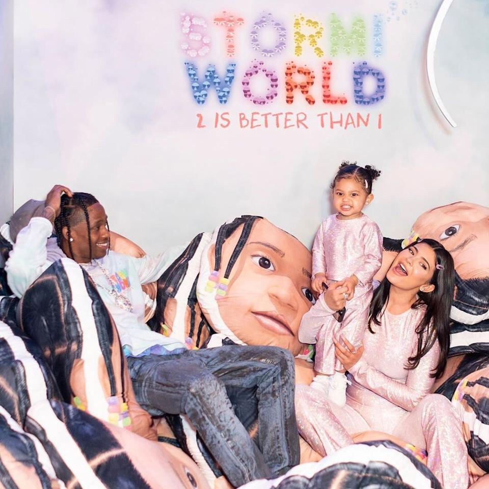 "For her second birthday, the toddler kicked off her <a href=""https://people.com/parents/kylie-jenner-daughter-stormi-2nd-birthday-party/"">StormiWorld 2 amusement park-themed bash</a> with her parents, Kylie Jenner and rapper Travis Scott."