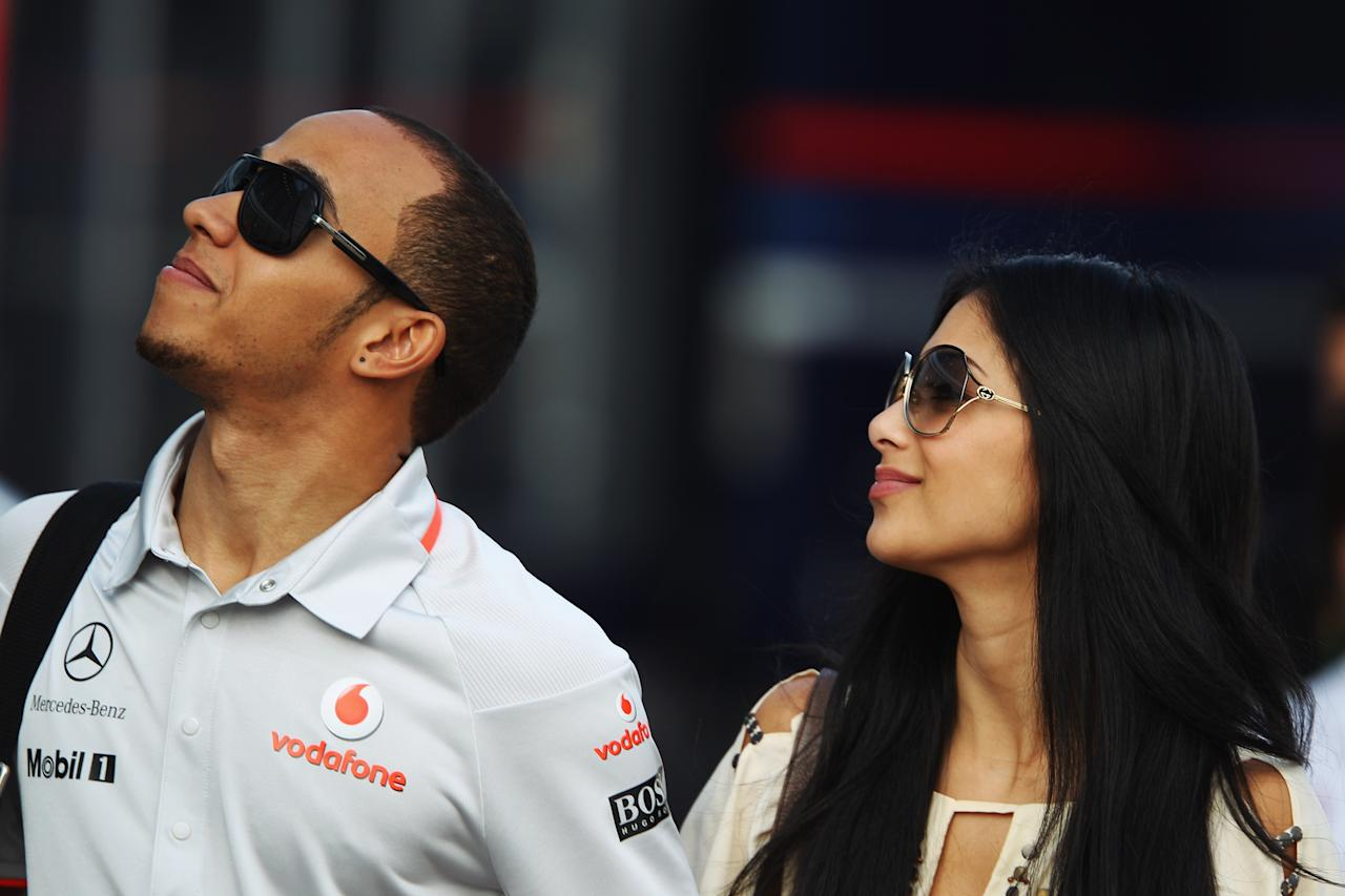 ISTANBUL, TURKEY - MAY 29:  Lewis Hamilton of Great Britain and McLaren Mercedes and his girlfriend Nicole Scherzinger of the Pussycat Dolls walk in the paddock following qualifying for the Turkish Formula One Grand Prix at Istanbul Park on May 29, 2010, in Istanbul, Turkey.  (Photo by Mark Thompson/Getty Images)