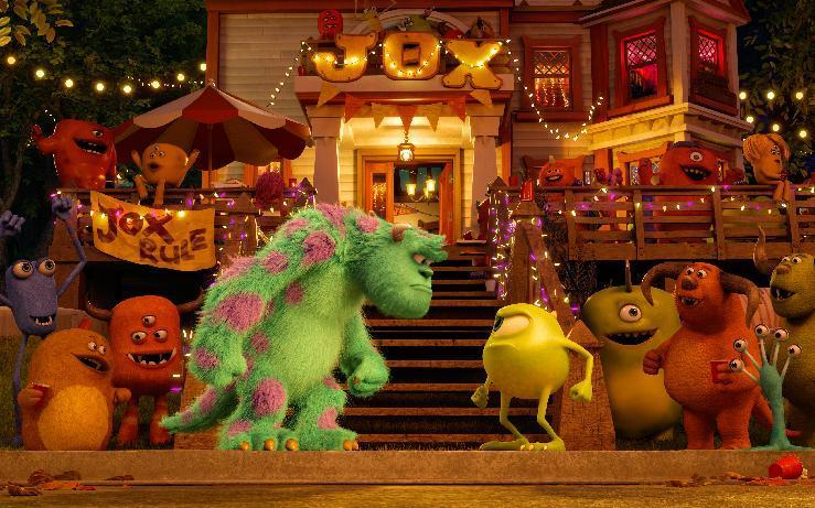 """This film publicity image released by Disney-Pixar shows characters Sulley, center left, voiced by John Goodman, and Mike, center left, voiced by Billy Crystal in a scene from """"Monsters University."""" (AP Photo/Disney-Pixar)"""