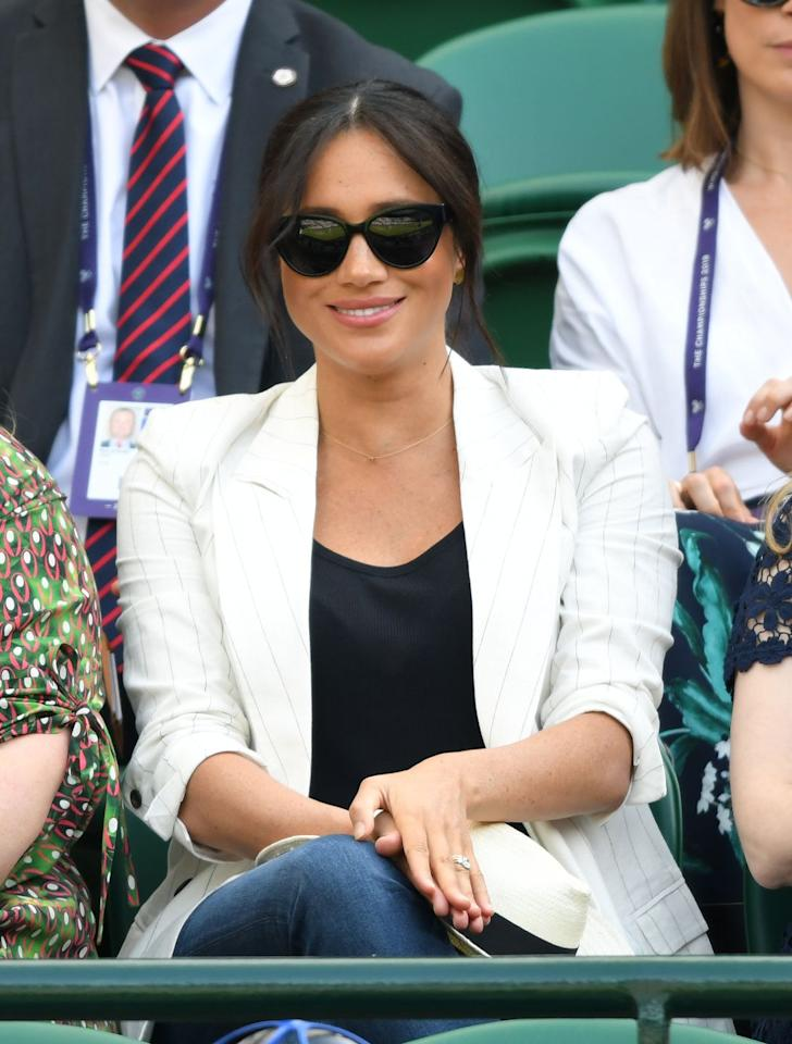 <p>The Duchess of Sussex cheers on her friend Serena Williams while wearing a casual blazer and jeans.</p>