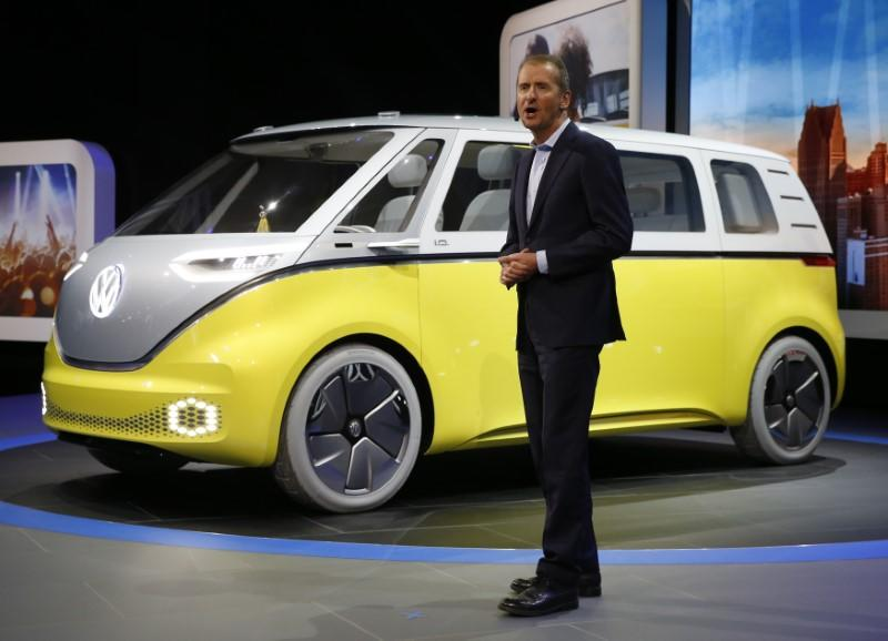 Volkswagen chairman Herbert Diess speaks near an electric I.D. Buzz concept vehicle during the North American International Auto Show in Detroit