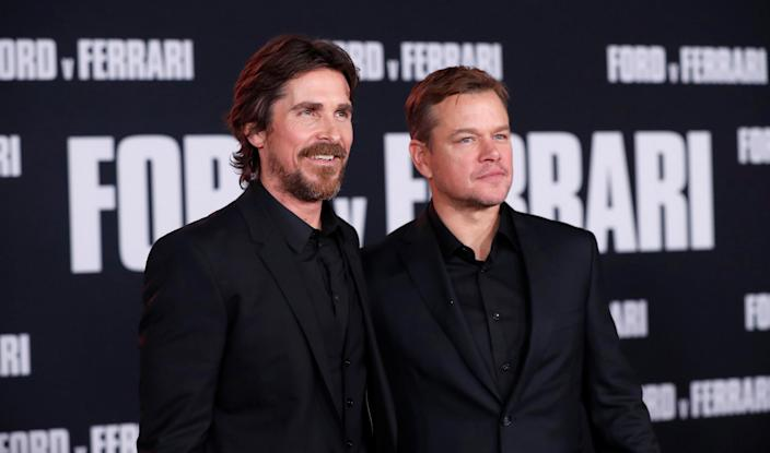 """Cast members Christian Bale and Matt Damon pose at a special screening for the movie """"Ford v Ferrari"""" in Los Angeles, California, U.S., November 4, 2019. REUTERS/Mario Anzuoni"""
