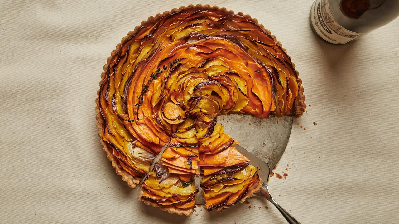 """We aren't going to try to stop you from serving tofu turkey if that is how you roll on Thanksgiving, but for a vegetarian main that can hold its own at the center of the table, this tart makes a very convincing argument. <a href=""""https://www.bonappetit.com/recipe/squash-and-caramelized-onion-tart?mbid=synd_yahoo_rss"""">See recipe.</a>"""