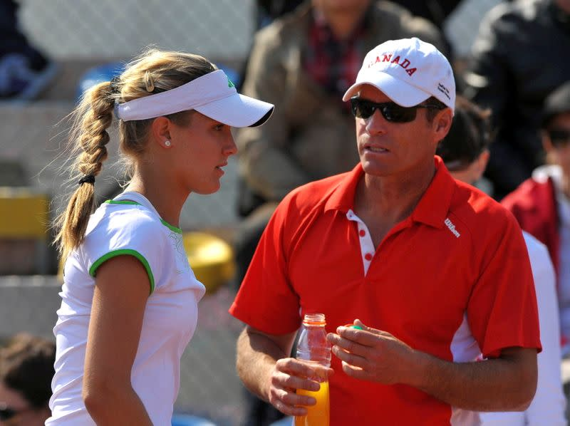 FILE PHOTO: Canada's head coach Sylvain Bruneau speaks with Eugenie Bouchard during her Fed Cup World Group tennis match against Slovenia's Polona Hercog in Koper