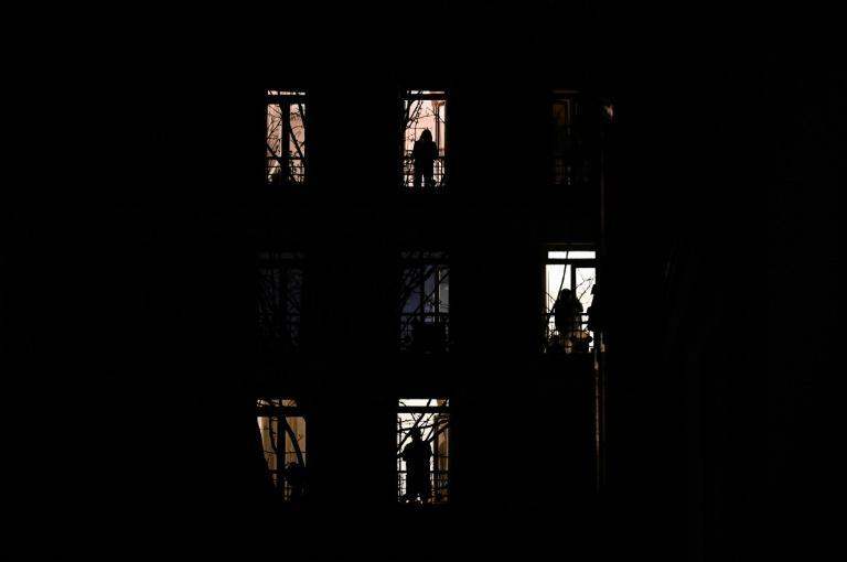 People stand by their windows and applause in solidarity with healthcare workers on the frontline of the coronavirus outbreak in Paris in March