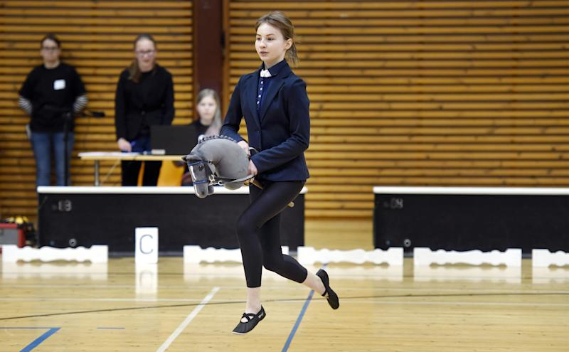 Ella Holm and hobby horse Fede compete during the hobby horsing Finnish championships in Vantaa, Finland, Saturday, April 29, 2017. (Heikki Saukkomaa/ Lehtikuva via AP)