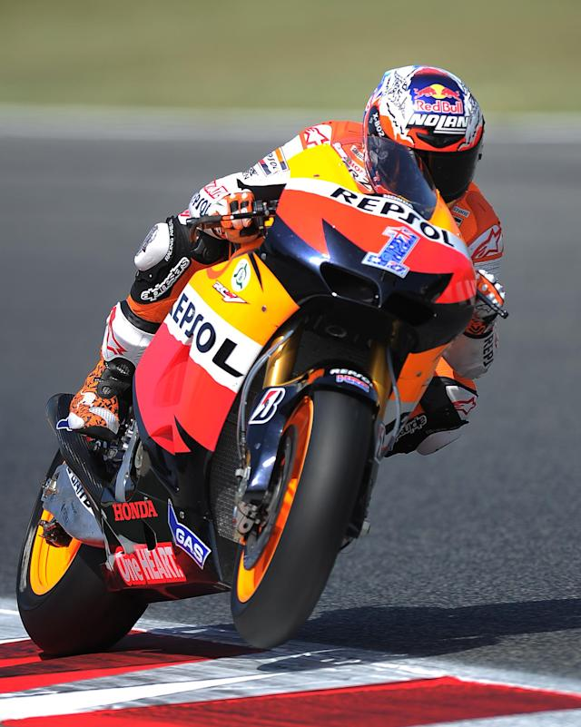 Repsol Honda Team's Australian Casey Stoner rides at the Catalunya racetrack in Montmelo, near Barcelona, on June 2, 2012, during the MotoGP third training session of the Catalunya Moto GP Grand Prix. AFP PHOTO/LLUIS GENELLUIS GENE/AFP/GettyImages