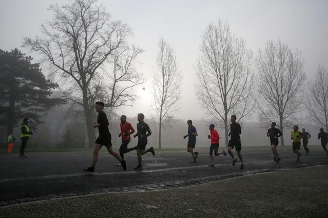 A file image of joggers in a chilly Finsbury Park, north London, last week. A cold snap is set to hit the UK in time for election day (Dinendra Haria/SOPA Images/Sipa USA)
