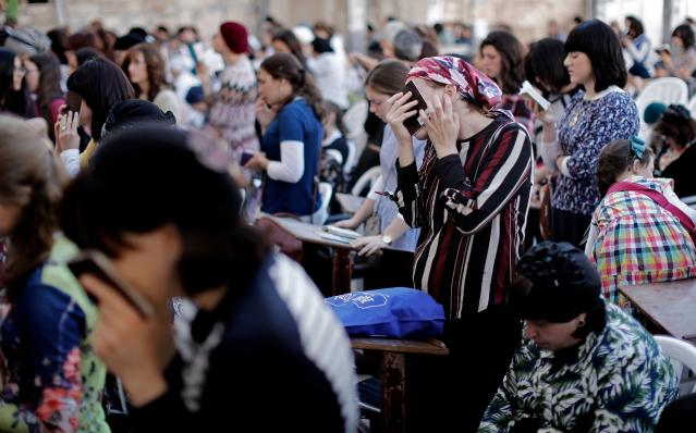 <p>Religious Jewish women pray at the women's section of the Western Wall in the Old City of Jerusalem on the eve of Yom Kippur also known as the Day of Atonement, the holiest day of the year in Judaism, on Sept. 28, 2017. (Photo: Thomas Coex/AFP/Getty Images) </p>