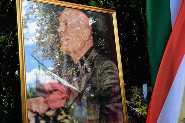 COMO, ITALY - MAY 02:   A photo of Benito Mussolini is displayed during ceremony for the death of Italian dictator Benito Mussolini and his mistress, Claretta Petacci in front of a headstone of the place where they were executed, on May 2, 2021 in Como, Italy. Benito Mussolini founded and led the National Fascist Party. He served as Prime Minister from 1922 until 1943 when he was removed during the Italian Civil War. He was executed on 28 April 1945.  (Photo by Pier Marco Tacca/Getty Images) (Photo: Pier Marco Tacca via Getty Images)