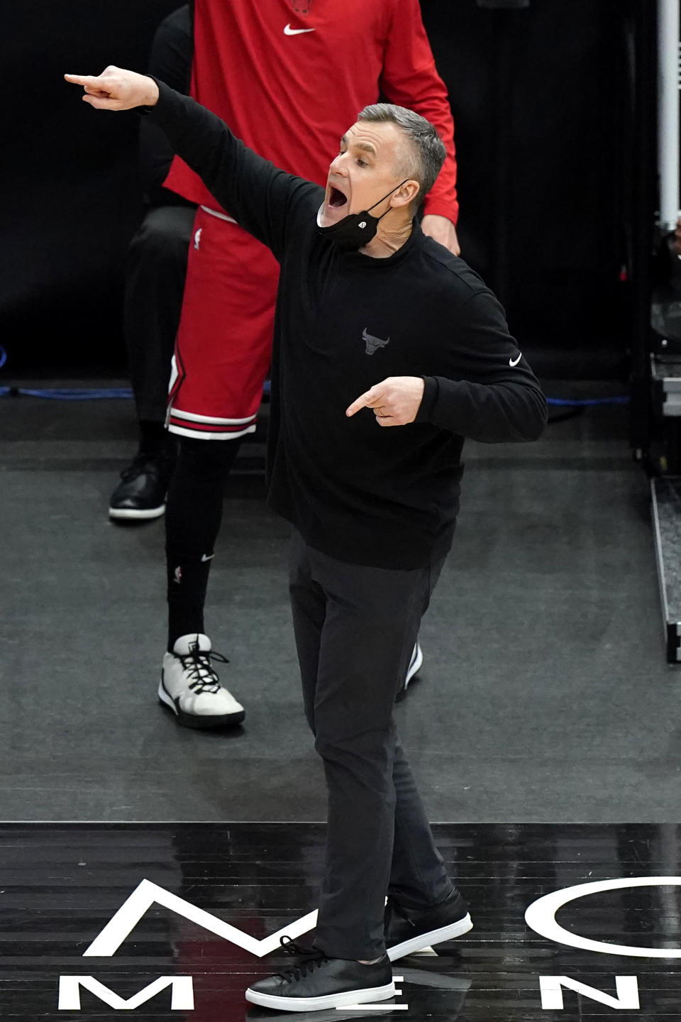 Chicago Bulls coach Billy Donovan gives out directions to the team during the first half of an NBA basketball game against the Toronto Raptors in Chicago, Thursday, May 13, 2021. (AP Photo/Nam Y. Huh)