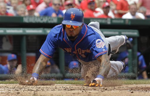New York Mets' Jordany Valdespin slides head first into home plate to score on a double by Daniel Murphy during the third inning of a baseball game against the St. Louis Cardinals Thursday, May 16, 2013, in St. Louis. (AP Photo/Jeff Roberson)