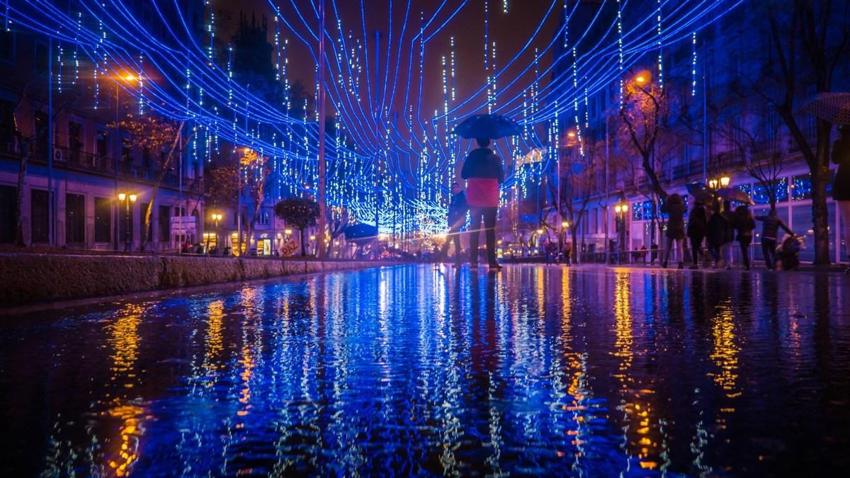 """Beginning on the last Friday of November, the streets of Madrid come alive with millions of lights strewn up in the downtown area. These <a rel=""""nofollow"""" href=""""https://www.esmadrid.com/en/christmas-in-madrid?utm_referrer=https%3A%2F%2Fwww.google.com%2F"""">eco-friendly lights</a> are created by Spanish designers, architects, and graphic designers who are known forpaying homage to Madrid's fashion-conscious streets. Tall Christmas trees and dazzling light displays cover nearly every inch of the city, including popular tourist destinations likePuerta del Sol, Plaza San Juan de la Cruz and Plaza España, Red de San Luis (Gran Vía-Montera), Calle Fuencarral, Plaza de Callao and Plaza de Colón (Calle Génova)."""