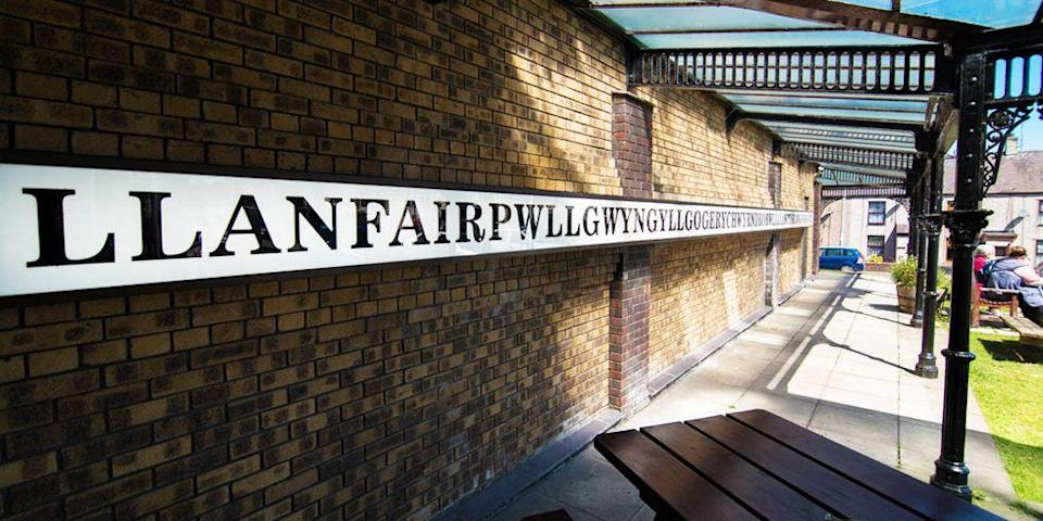 """<p>This small village of approximately 300 people in Wales was initially called Llanfair Pwllgwyngyll before the name was changed to Llanfairpwll … er, what's written above. The 58-letter name was invented in the 1860s for tourist and promotional purposes, but we're not quite sure how well that's working out for them.</p><p><a href=""""https://www.housebeautiful.com/lifestyle/a6078/erin-ben-small-town-living/"""" rel=""""nofollow noopener"""" target=""""_blank"""" data-ylk=""""slk:The best things about living in a small town »"""" class=""""link rapid-noclick-resp""""><em>The best things about living in a small town »</em></a></p>"""