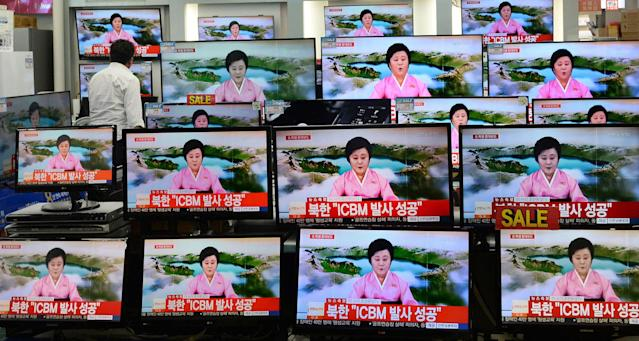 <p>TV screens at a Yongsan Electronic shop show a North Korean newscaster reading a public announcement at in Seoul, South Korea, Tuesday, July 4, 2017. (Photo: Lim Tae-hoon/Newsis via AP) </p>