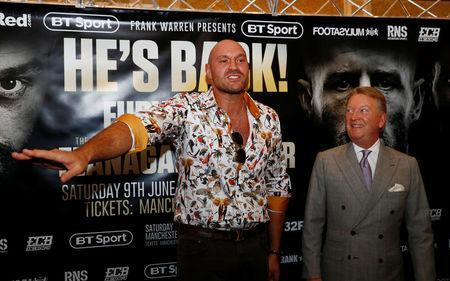 Boxing - Tyson Fury & Sefer Seferi Press Conference - The Midland Hotel, Manchester, Britain - June 6, 2018 Tyson Fury and promoter Frank Warren after the press conference Action Images via Reuters/Jason Cairnduff