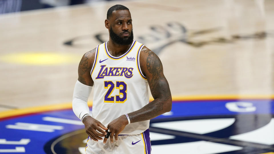 Los Angeles Lakers forward LeBron James takes the court before the team's NBA basketball game against the Denver Nuggets on Sunday, Feb. 14, 2021, in Denver. (AP Photo/David Zalubowski)