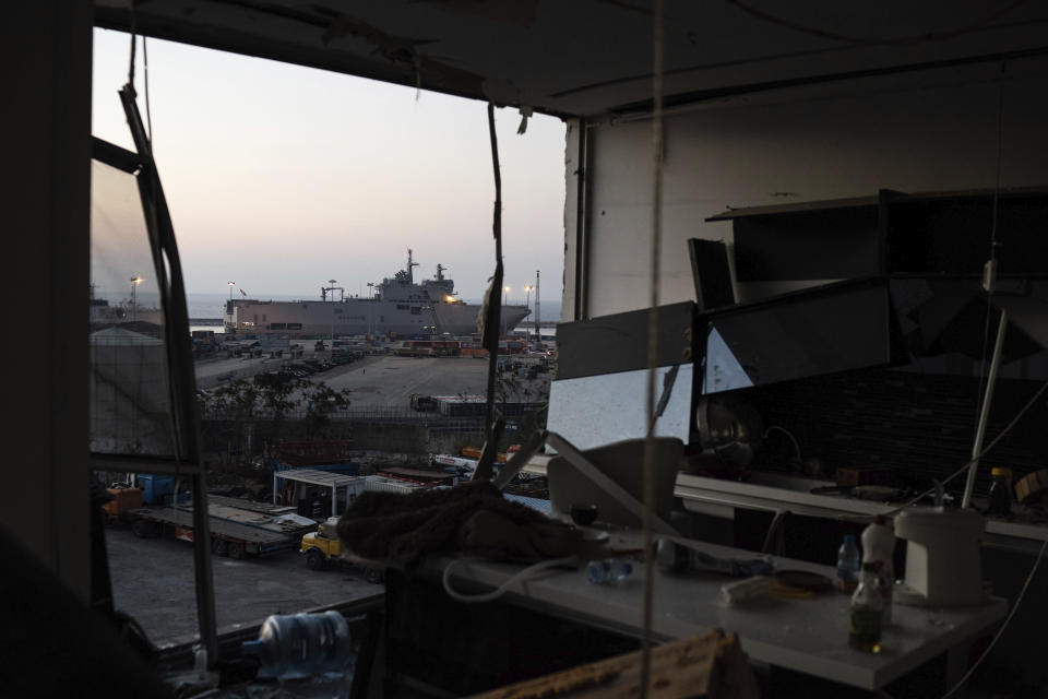 French helicopter carrier Tonnerre, top left, is docked near the site of the Aug. 4 explosion, in Beirut, Lebanon, Friday, Aug. 14, 2020. (AP Photo/Felipe Dana)