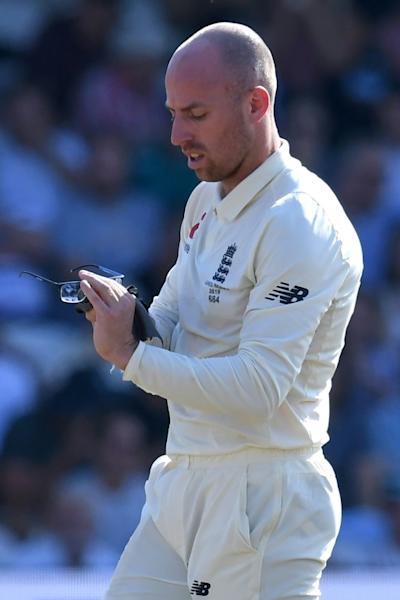 England's Jack Leach cleans his glasses during a break in play (AFP Photo/Paul ELLIS)