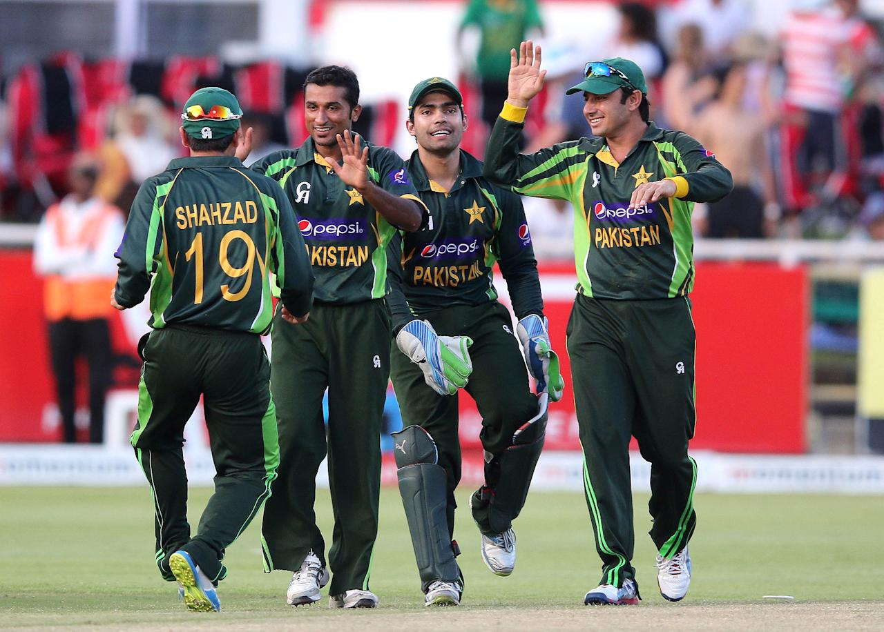 Pakistan's Bilawal Bhatti (2nd L) celebrates the win with teammates during the first One day International (ODI) Cricket Match between Pakistan and South Africa at Newlands Cricket Ground in Cape Town on November 24, 2013. AFP PHOTO / ANESH DEBIKY        (Photo credit should read ANESH DEBIKY/AFP/Getty Images)