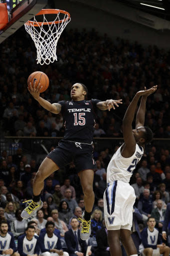 Temple's Nate Pierre-Louis (15) goes up for a shot against Villanova's Dhamir Cosby-Roundtree during the first half of an NCAA college basketball game, Wednesday, Dec. 5, 2018, in Villanova, Pa. (AP Photo/Matt Slocum)