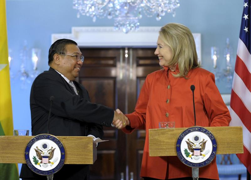 Secretary of State Hillary Rodham Clinton shakes hands with Myanmar's Foreign Minister U Wunna Maung Lwin, Thursday, May 17, 2012, at the State Department in Washington. (AP Photo/Susan Walsh)