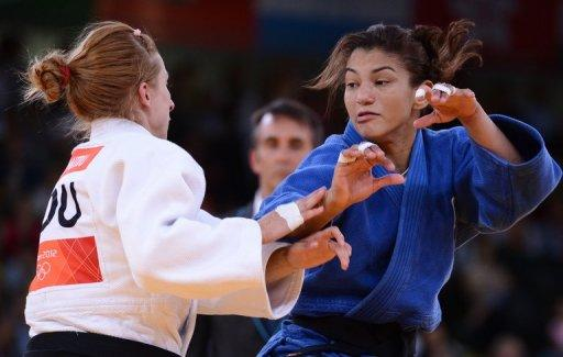 Brazil's Sarah Menezes (right) competes with Romania's Alina Dumitru at the London 2012 Olympics on July 28