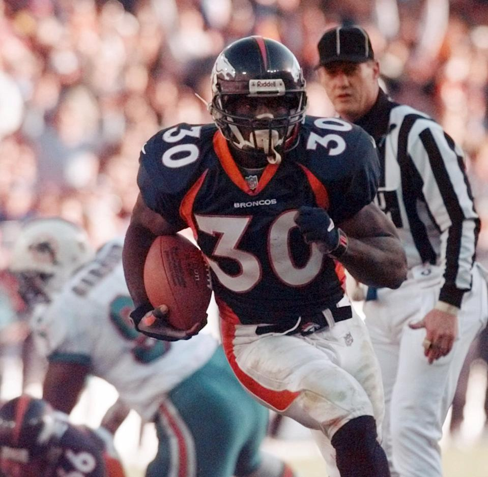 Denver Broncos running back Terrell Davis breaks into the endzone on a 20-yard touchdown run against the Miams Dolphins during the first quarter of action at Mile High Stadium on Saturday, Jan 9, 1999. (AP Photo/Bob Galbraith)