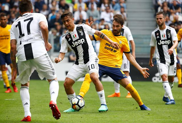 Soccer Football - Serie A - Juventus vs Hellas Verona - Allianz Stadium, Turin, Italy - May 19, 2018 Juventus' Paulo Dybala in action with Hellas Verona's Marco Fossati REUTERS/Stefano Rellandini