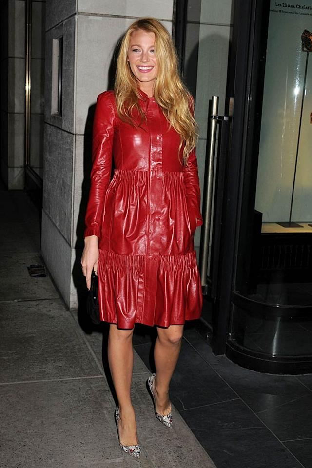 As usual, Blake Lively looked red hot in the Valentino ruched leather coat and sexy snakeskin heels she was spotted sporting at a Christian Louboutin cocktail party at Barney's New York. (11/1/2011)